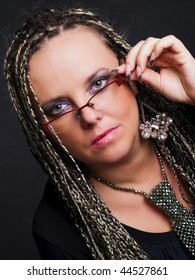 party woman in braids and glasses