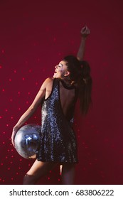 Party woman with disco ball