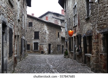 Paruzhes, France - December 20, 2016: Stone houses with a tiled roof in the medieval village (commune) near Lyon. The place where the historic shoot movies in December 20, 2016, Paruzhes, France