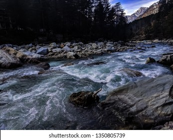The Parvati River in the Parvati Valley behind the town Kasol in Himachal Pradesh, India. The flow of the river is audible throughout the valley and the current of the river makes it dangerous.