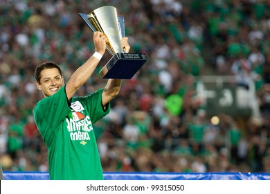 """PASADENA, CA - MAY 25: Mexico F player Javier """"Chicharito"""" Hernandez #14 receives the Golden Boot Award after the 2011 CONCACAF Gold Cup championship game on May 25. 2011 at a sold out Rose Bowl in Pasadena, CA."""