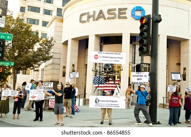 PASADENA, CA - OCTOBER 12: Supporters of the Occupy Wall Street protest rally in Pasadena as Occupy Pasadena in front of major banks on October 12, 2011.