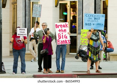 PASADENA, CA - OCTOBER 12: Supporters of the Occupy Wall Street protest rally as Occupy Pasadena in front of major banks on October 12, 2011 in Pasadena, CA.