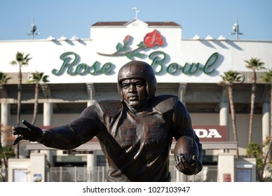 Pasadena, CA / USA - Feb. 17, 2018: A statue of the color barrier breaking, multi-sport athlete, Jackie Robinson, is shown in his college football attire outside the Rose Bowl Stadium.