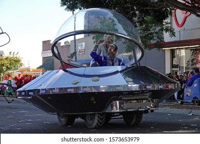 """Pasadena, CA / USA - Nov. 24, 2019: A man and woman are shown in a custom UFO shaped vehicle at the 42nd annual Pasadena Doo Dah Parade, which is called """"an irreverent alternative to the Rose Parade""""."""