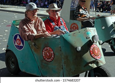 """Pasadena, CA / USA - Nov. 24, 2019: Vintage Autoette electric carts are  shown at the Pasadena Doo Dah Parade, which began in 1978 and is billed as """"an irreverent alternative to the Rose Parade."""""""