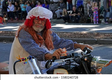 """Pasadena, CA / USA - Nov. 24, 2019: A man dressed as the character Raggedy Ann is shown riding a motorcycle at the quirky, """"42nd Occasional"""" Pasadena Doo Dah Parade."""