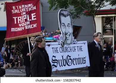 "Pasadena, CA / USA - Nov. 24, 2019: Church of the SubGenius members dressed as figurehead J.R. ""Bob"" Dobbs participate in the ""42 Occasional"" Pasadena Doo Dah Parade."