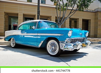 PASADENA, CALIFORNIA - JUNE 19, 2016: A classic 1956 Chevy Bel Air is parked along the road on Green Street in Pasadena, California USA