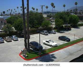 PASADENA, CALIFORNIA – JUNE 30: Half-filled motel parking lot before more guests arrive on June 30, 2012 in Pasadena, CA. Designed for motorists, the number of motels peaked in the 1960's.