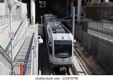 PASADENA, CALIFORNIA, USA - SEPTEMBER 20: A Gold Line train leaves the Memorial Park Station for Downtown Los Angeles on September 20, 2012.  The extension of the line to Azusa is now underway.