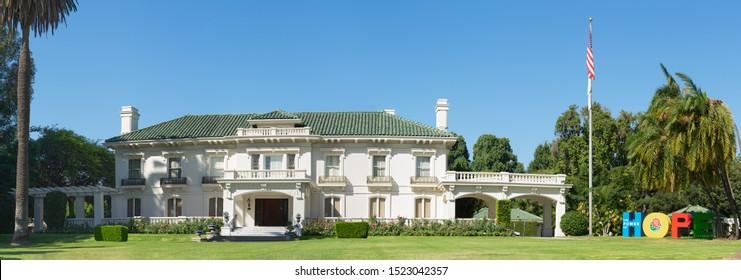 PASADENA, CA/USA - OCTOBER 5, 2019:  panoramic of the Wrigley Mansion or Tournament House including the Rose Parade Tournament 2020 Theme, HOPE.