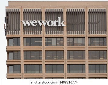 PASADENA, CA/USA - SEPTEMBER 8, 2019: wework sign. Wework is an American company which provides shared workspace, community, and services for entrepreneurs, freelancers, startups and small businesses.
