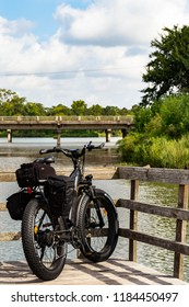 Pasadena, TX, US - Dec 4, 2009: e bike(electric bike) with Panniers on the dock at Bay Area Park in Pasadena Texas.