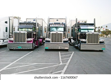 PASADENA/CALIFORNIA - AUG. 16, 2018: Big rig trucks & trailers parked in the parking lot of the Rose Bowl Stadium in Pasadena, California USA