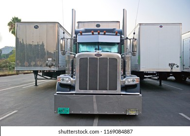 PASADENA/CALIFORNIA - AUG. 16, 2018: Big rig truck and trailers parked in the parking lot of the Rose Bowl Stadium in Pasadena, California USA