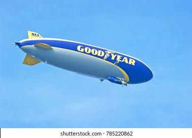 PASADENA/CALIFORNIA - JAN. 1, 2018: Goodyear Windfoot 2, a semi-rigid airship hovers over the city of Pasadena before the start of the Rose Bowl Game. Pasadena, California USA