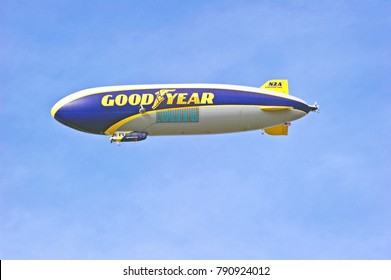 PASADENA/CALIFORNIA - JAN. 1, 2018: Goodyear Wingfoot 2, a semi-rigid airship hovers over the city of Pasadena before the start of the Rose Bowl game on New Years day. Pasadena, California USA