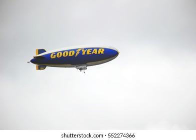 PASADENA/CALIFORNIA - JAN. 2, 2017: Goodyear Blimp, a non-rigid airship without an internal structural framework or keel flies over the Rose Bowl Stadium on a cloudy day in Pasadena, California USA