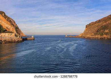 Pasaia Donibane,Guipuzcoa/España;12 25 2018: The entrance to the city by the sea between the lighthouses