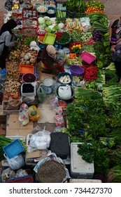 Pasar Besar Siti khadijah, Kota Bharu circa 13 October 2017. A woman vegetable seller at the wet market.