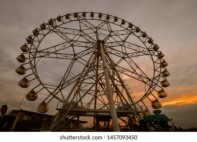 Pasay City, Philippines - Jan. 9, 2013: Ferris wheel silhouetted against late afternoon western skies.