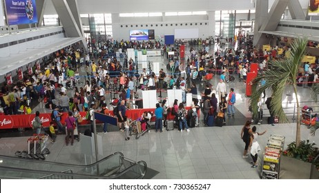 PASAY, MANILA PHILIPPINES—FEBRUARY 2016: Passengers flock to the domestic check-in counters of different airlines at the Ninoy Aquino International Airport Terminal 3 in Manila.