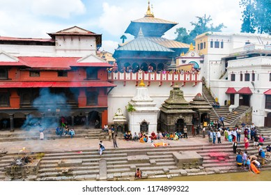 Pashupatinath, Nepal - July 17, 2018 : Cremation ritual at Pashupatinath, a famous and sacred Hindu temple complex, located on banks of the Bagmati River and UNESCO World Heritage Site since 1979