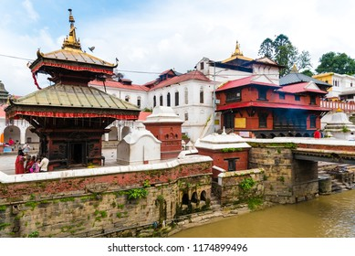 Pashupatinath, Nepal - July 17, 2018 : View over Pashupatinath, a famous and sacred Hindu temple complex, located on banks of the Bagmati River and UNESCO World Heritage Site since 1979