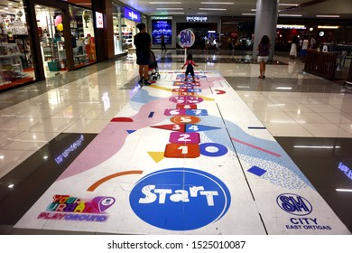 PASIG CITY, PHILIPPINES – OCTOBER 5, 2019: Hop scotch game placed on the floor of well known mall for customers to enjoy