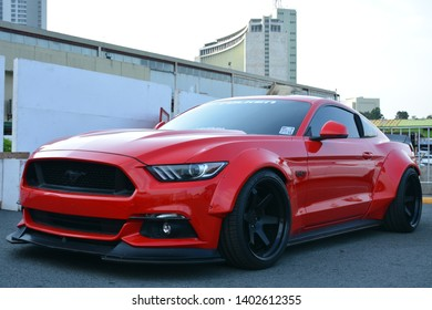 PASIG, PH - MAY 18: Red Ford Mustang at First U-Trip Rebuilt Truck Show on May 18, 2019 in Pasig, Philippines.