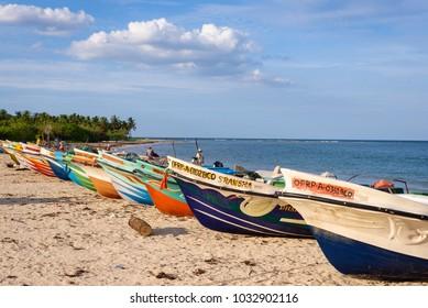 PASIKDA BEACH, KALKUDA, SRI LANKA, sept. 15, 2017. Traditional sri lankan fishing boats laying on the beach in Pasikuda on Sept. 15, 2017 in Sri Lanka.