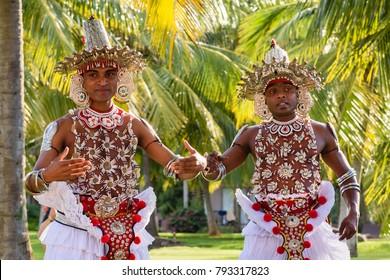 PASIKDU BEACH, KALKUDA, SRI LANKA, sept. 15, 2017. Traditionally dressed men dancing the Kandyan dance on beach wedding. The dance is usally danced on festival in Kandy on Sept. 15, 2017 in Sri Lanka.