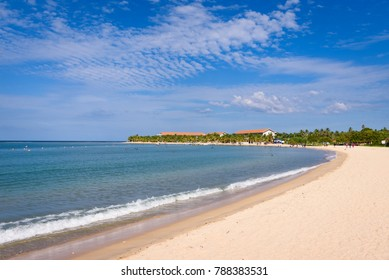 Pasikuda beach in Kalkuda, Sri Lanka. A paradise beach with calm ocean and large white sand beach with palm trees and resort in background on east coast of Sri Lanka.