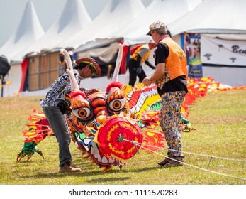 Pasir Gudang, Malaysia - March 3, 2018: Large kite train in traditional, Indonesian dragon style being prepared for take-off at the Pasir Gudang World Kite Festival in the Johor State of Malaysia.