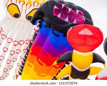 Pasir Gudang, Malaysia - March 3, 2018: Large, soft kites flying at the Pasir Gudang World Kite Festival in the Johor State of Malaysia.