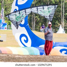 Pasir Gudang, Malaysia - March 3, 2019: Canadian kite flier Steve De Rooy flying a quad line kite on short lines at the 24th Pasir Gudang World Kite Festival with participants from 43 nations.