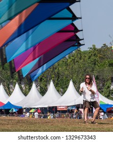 Pasir Gudang, Malaysia - March 3, 2019: Scottish kite flier Tom Greenfield flying a stack of 8 quad line kites at the 24th Pasir Gudang World Kite Festival with participants from 43 nations.