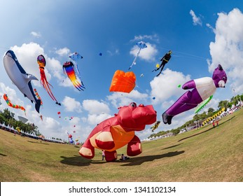 Pasir Gudang, Malaysia - March 3, 2019: Soft kites depicting a hippopotamus and other animals flying at the 24th Pasir Gudang World Kite Festival with participants from 43 nations.