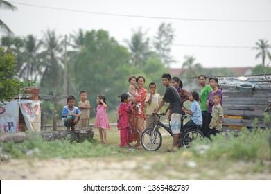 Pasir Puteh, MALAYSIA. December 2012. A family of villagers at the rural area. Happy, cheerful but looked curios to the outsider people. Economically poor, but still can live with happy and peaceful.