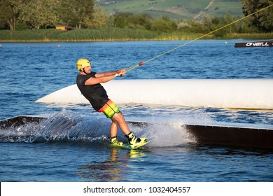 PASOHLAVKY, CZECH REPUBLIC - JUNE 26, 2017: Rider wakeboarding in the cable wake park Wake Merkur in South Moravia