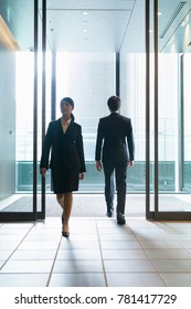 Pass each other Japanese businesswoman and businessman