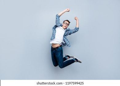Pass exam, examen, examination on good-mark! Full length, legs, body, size profile side view portrait of good-looking guy raised fists up, open mouth and eyes isolated on light gray background