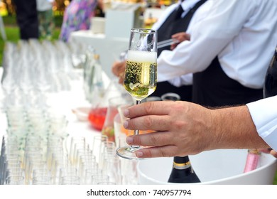 To pass a glass of Champagne during a party. Take a glass