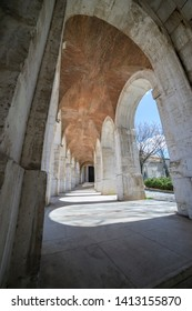 passage with columns and arches. Church of San Antonio in Aranjuez, Madrid, Spain. Stone arches and walkway linked to the Palace of Aranjuez