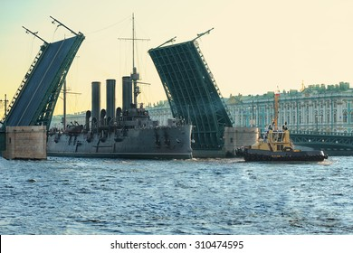 Passage of cruiser Aurora under the Palace Bridge, St. Petersburg, Russia