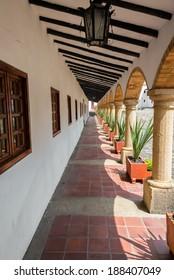 Passage lined with arches in La Candelaria Monastery near Villa de Leyva, Colombia