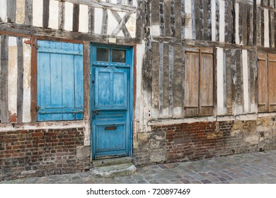 Passage with old medieval houses downtown in Honfleur, France