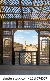 Passage surrounding the Mosque of Ibn Tulun framed by interleaved wooden perforated wall - Mashrabiya - Medieval Cairo, Egypt