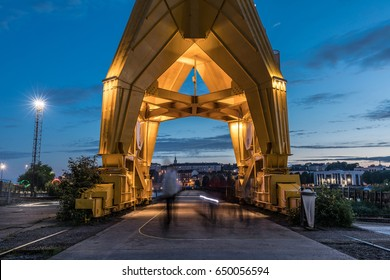 Passage under the yellow crane titan by night in Nantes, France